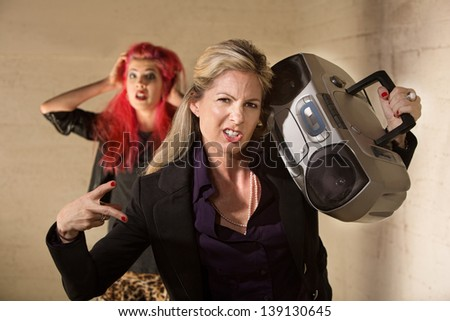 Awkward funny woman with radio and embarrassed teenager - stock photo