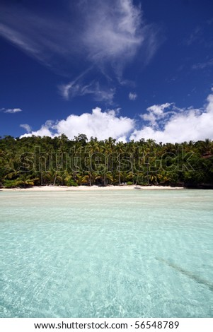 Awsome beautiful scene at the beach, blue sky with one white cloud, only white sand and the sea, the place for relaxing
