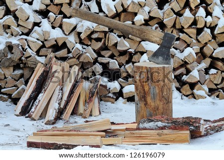 Ax and firewood in the country - stock photo