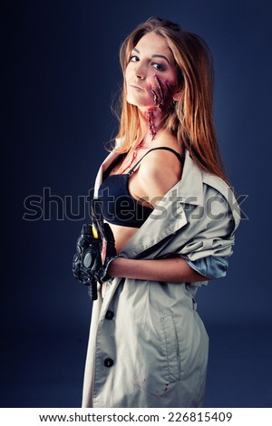 Axe with blood in female hand. Killer or butcher, halloween theme - stock photo