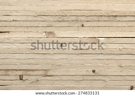 Axes of light wood arranged one above the other. - stock photo