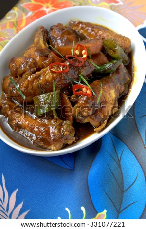 Ayam Kicap or kecap - chicken cooked or stew in black soy gravy with herbs and spices. Famous food in South East Asia