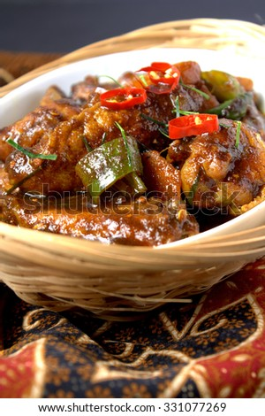 Ayam Kicap or kecap - chicken cooked or stew in black soy gravy with herbs and spices. Famous food in South East Asia - stock photo