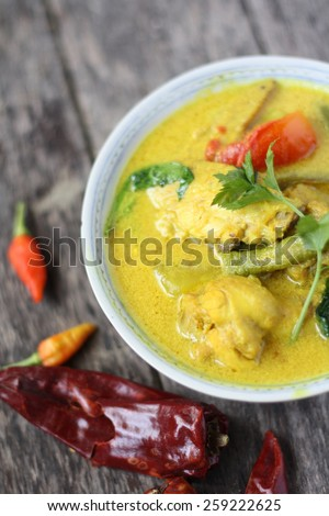 Ayam Masak Lemak- Traditional Malay Cuisine. Chicken cook with tumeric herbs, coconut milk, spices and tomatoes - stock photo