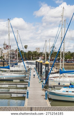 "AYAMONTE, SPAIN - MAY 5 2015. Luxury boats and yachts are moored in Ayamonte marina, ""Puerto Deportivo Ayamonte"" it has a capacity of 317 berths for vessels of 25 meters of length. - stock photo"