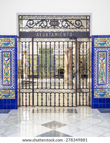 "AYAMONTE, SPAIN - MAY 15 2015. The ornate entrance gates to Ayamonte's town hall. The ""Ayuntamiento"". In Huelva province, Andalucia. - stock photo"