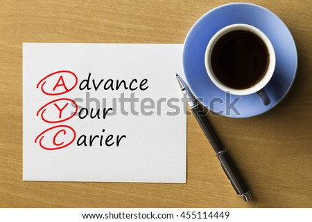 AYC Advance Your Career - handwriting on notebook with cup of coffee and pen, acronym business concept