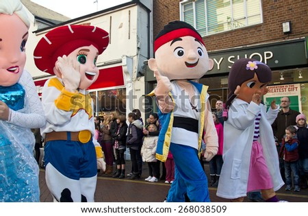 AYLESBURY, UK - NOVEMBER 30: Performers dressed in cartoon character costumes parade through Aylesbury town centre as part of the Xmas Festival parade on November 30, 2014 in Aylesbury - stock photo