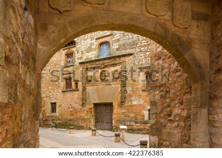 AYLLON, SPAIN - MAY 15 2016: Gate of the city and facade of Contreras palace in Ayllon, Segovia, Castile and Leon, Spain - stock photo