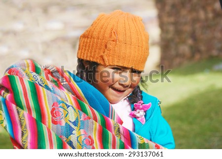 Aymara girl playing with traditional cloth - stock photo
