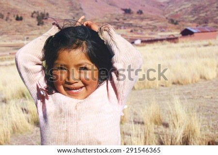 Aymara girl smiling - stock photo