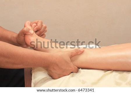 Ayurvedic spa foot leg massage close up - stock photo