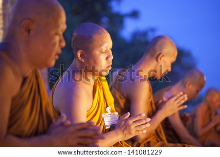 AYUTHAYA, THAILAND - JUN 24 : The practices clergy of Buddhists in Visakha Puja Day on June 24, 2013. Visakha Puja Day is the 3 important incidents of Budhha, birth day, enlightenment and nibbana.