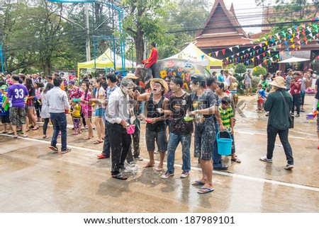 AYUTTAYA, THAILAND - APRIL 14, 2014: Songkran Festival is celebrated in a traditional New Year's Day from April 13 to 15,People enjoy with the splashing water and face powder in Ayuttaya, Thailand.