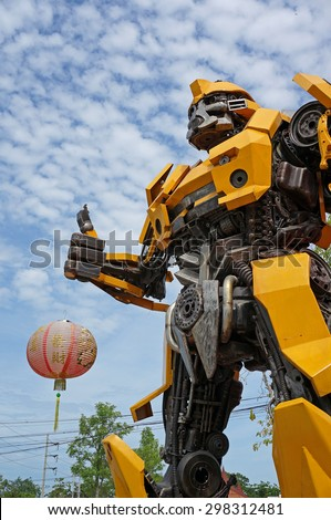 AYUTTAYA,THAILAND - JUNE 13, 2015 : The Replica of Bumblebee robot made from iron part of a Car display at Thung Bua Chom floating market - stock photo