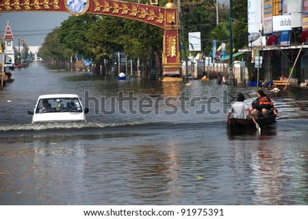 AYUTTAYA, THAILAND-NOVEMBER 5: Transportation of people in the streets flooded after the heaviest monsoon rain in 50 years in the capital on November 5, 2011 Rostjana Road, Ayuttaya, Thailand. - stock photo