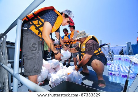 AYUTTAYA, THAILAND - OCT 22: Thai military transport food supplies to help people after the city was flooded during the monsoon season on October 22, 2011 in Bangkok, Thailand. - stock photo