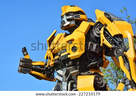 AYUTTAYA,THAILAND - OCTOBER 14, 2014 : The Replica of Bumblebee robot made from iron part of a Car display at Thung Bua Chom floating market  - stock photo
