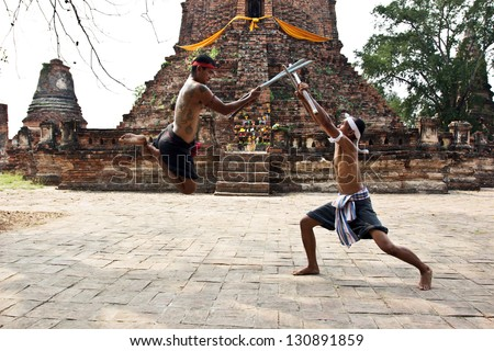 AYUTTHAYA - FEB 18: Fighters take part in a Muay Boran demonstration at Wat Worachet on Feb 18, 2013 in Ayutthaya, Thailand. Muay Boran refers to Thai kickboxing before modern rules were introduced. - stock photo