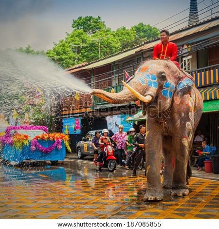 AYUTTHAYA, THAILAND - APRIL 13: Songkran Festival is celebrated in a traditional New Year's Day from April 13 to 15, with the splashing water with elephants on April 13, 2014 in Ayuttaya, Thailand.  - stock photo