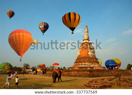AYUTTHAYA,THAILAND - DECEMBER 6, 2009 : Hot air balloon show on ancient temple in Thailand International Balloon Festival 2009 at Ayutthaya Historical Park of Thailand , Ayutthaya old city,Thailand. - stock photo
