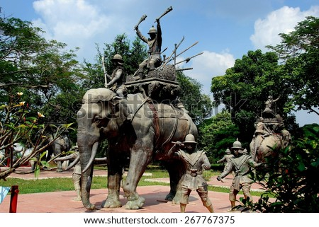 Ayutthaya, Thailand - December 23, 2010:   War Memorial with sculpted elephants, warriors, and seated monarch commemorating the Thai King's Victory over the Burmese Army stands in an open park * - stock photo