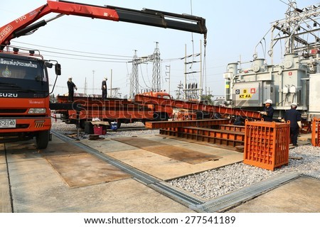 AYUTTHAYA -THAILAND - DECEMBER 10 : Workers and preparation equipment. The transformer to be installed in high-voltage station., December 9, 2014 in Ayutthaya province, Thailand