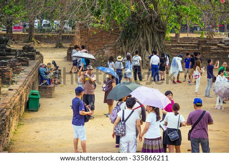 AYUTTHAYA , THAILAND - FEB 20, 2015: On territory monastery Wat Mahathat can be seen strolling tourists. Many tourists visit Ayutthaya in February - stock photo