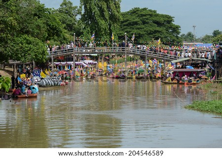 AYUTTHAYA, THAILAND - JULY 11: Beautiful flower boats in floating parade, the unique annual candle festival of Buddhist lent on July 11, 2014  in Ladchado, Ayutthaya, Thailand