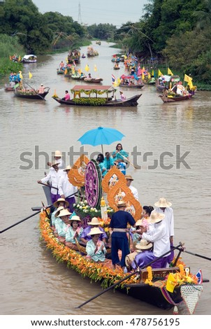 AYUTTHAYA, THAILAND - JULY 15,2011: Unidentified people dancing show on the flower boats in candle floating parade,the unique annual candle festival of Buddhist lent  in Lad Chado, Ayutthaya,Thailand.
