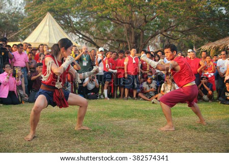 AYUTTHAYA,THAILAND - MARCH 17,2013: Demonstration of muay thai martial arts combat pose between man and woman during the Wai Kru Ceremony. - stock photo
