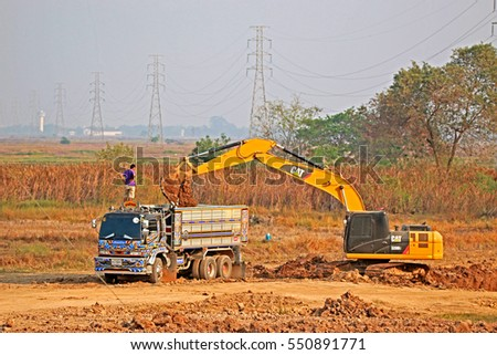 AYUTTHAYA-THAILAND-MARCH 19 : The Loader working at worksite on field on March 19, 2016 Ayutthaya Province, Thailand
