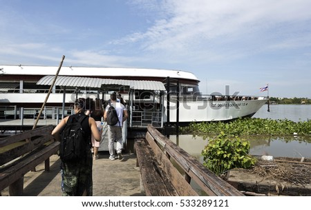 AYUTTHAYA, THAILAND - November 4, 2016: People boarding a boat for a river cruise down the Chao Phraya River from Ayutthaya to Bangkok in Thailand