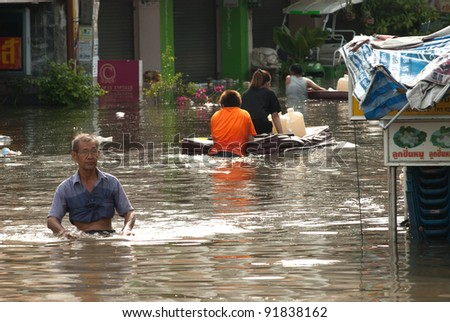 AYUTTHAYA, THAILAND - OCTOBER 9: Heavy flooding from monsoon rain in Ayutthaya and north Thailand arriving in Ayutthaya suburbs on October 9, 2011 in Ayutthaya, Thailand - stock photo