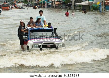 AYUTTHAYA, THAILAND - OCTOBER 9: Heavy flooding from monsoon rain in Ayutthaya and north Thailand arriving in Ayutthaya suburbs on October 9, 2011 in Ayutthaya, Thailand - stock photo