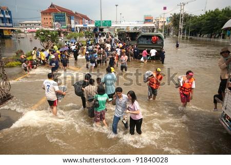 AYUTTHAYA, THAILAND - OCTOBER 9 : Heavy flooding from monsoon rain in Ayutthaya and north Thailand arriving in Ayutthaya suburbs on October 9, 2011 in Ayutthaya, Thailand. - stock photo