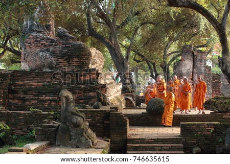 AYUTTHAYA, THAILAND, OCTOBER 2017 - Unknown Thai little monks are looking around the ruins of Wat Phra Srisanphet in Ayutthaya, Thailand, leaning about Ayutthaya era history.