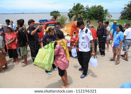 AYUTTHAYA THAILAND - SEP 11  : flood victims gather around volunteers for get some foods and drinking water on September 11,2011 in Ayutthaya Thailand - stock photo