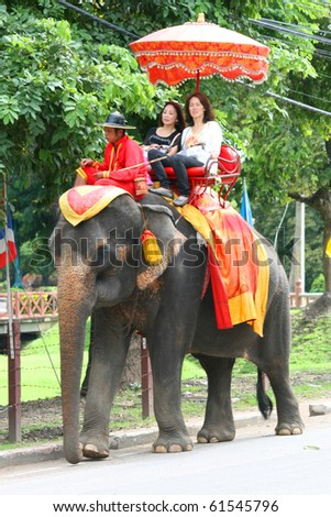 AYUTTHAYA, THAILAND - SEPTEMBER 6: Thai people on an elephant ride tour of the ancient city on September 6, 2010 in Ayutthaya. - stock photo