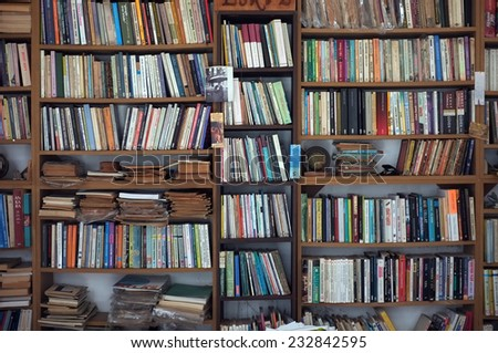 AYVALIK, TURKEY - AUGUST 09, 2014: Bookshelf with full of second hand books in a local shop in Ayvalik, Turkey - stock photo