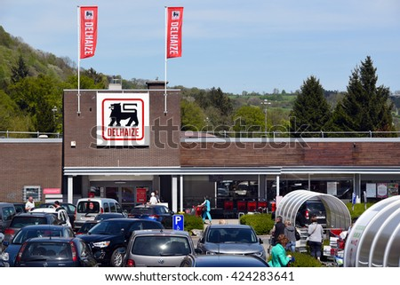 AYWAILLE, BELGIUM - MAY 6, 2016: Parking and entry of a Delhaize supermarket, part of Ahold Delhaize Group, an Dutch-Belgian international food retailer. Photo taken on May 6, 2016 - stock photo
