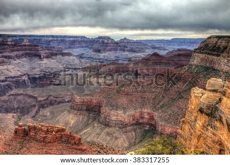 AZ-Grand Canyon National Park-S Rim-Rim Trail. Hiking the Rim Trail on a very overcast day was exciting, waiting for a storm to approach.  - stock photo