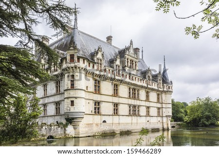 AZAY-LE-RIDEAU, FRANCE - JULY 15, 2012: Chateau Azay-le-Rideau (1515 - 1527) built on an island in Indre River - one of earliest French Renaissance chateaux.