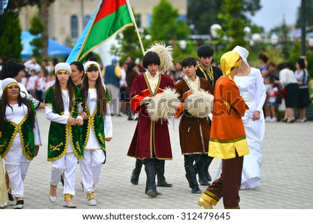 AZERBAIJAN, MASALLI, JUNE 13, 2014: Azerbaijan international folk festival 2014 in Masalli city. A Group of Azerbaijan folk musicians and dancers. - stock photo