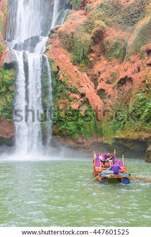 Azilal, Morocco - September 23, 2015: Tourists ride on makeshift rafts near the falls Ouzoud, Azilal, Morocco. Grand Atlas