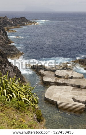 Azores coastline landscape with natural pool in Flores island. Portugal. Vertical - stock photo