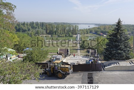AZOV, RUSSIA- AUGUST 29- Workers build a pedestrian stairway to the Don River on a summer day on August 29;2015 in Azov