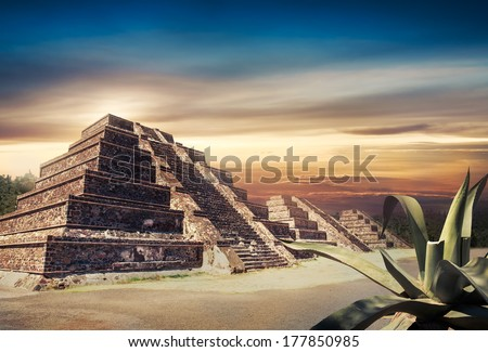 Aztec pyramid at sunset with dramatic sky and copy space, Not a real place, just a representation of ancient Mexico using parts of an actual pyramid to make the composite - stock photo