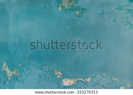 Azure blue peeled concrete wall.  - stock photo