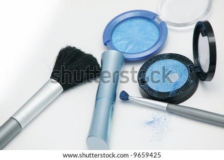 azure eyeshadows and brushes - stock photo